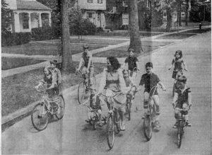 riding-bikes-down-street-in-mi-as-children-300x219
