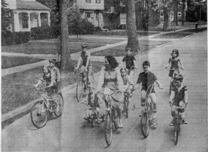 riding-bikes-down-street-in-mi-as-children-300x219